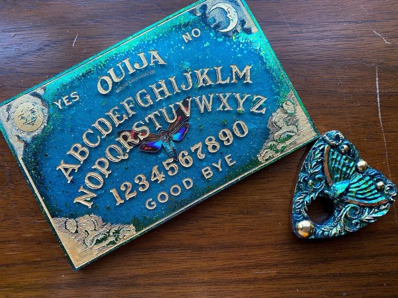 Gold and teal mini Ouija board set.