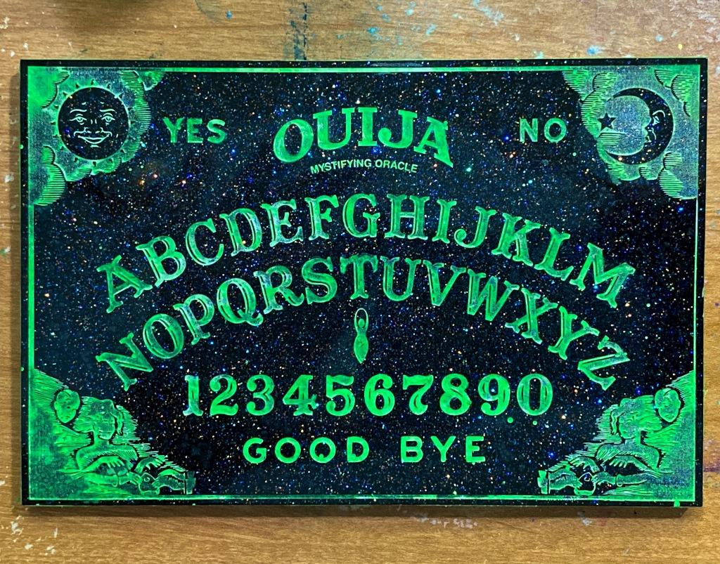 Alien glow in the dark Ouija board.