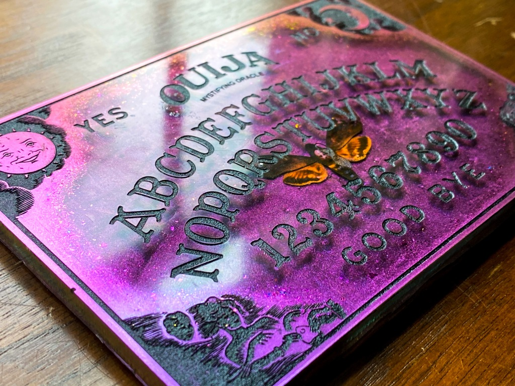 Pink to orange color shift Ouija board with death's head moth.