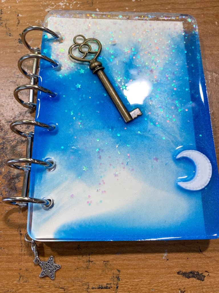 Custom blue refillable resin notebook.