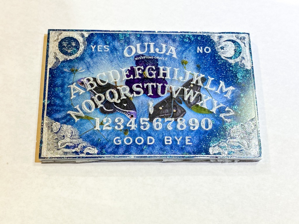 Blue and white moth and pansy ouija board.